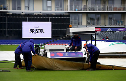 Ground staff adjust the rain covers during the ICC Cricket World Cup group stage match at Bristol County Ground.