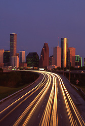 Stock photo of traffic streaming out of Houston on freeway I45N in the evening.