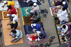 June 16, 2017 - Dhaka, Dhaka, Bangladesh - June 16, 2017 Dhaka, Bangladesh - Bangladeshi people attend to offer Friday prayers of Ramadan month in the mosque side in the street at Dhaka. Muslims around the world are observing the holy fasting month of Ramadan, celebrated with prayers, readings from the Koran, and gatherings with family and friends as they abstain from eating, drinking, smoking and sexual relations from dawn till dusk. (Credit Image: © K M Asad via ZUMA Wire)