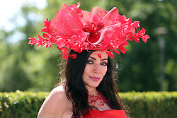 A fashionable racegoer during day three of Royal Ascot at Ascot Racecourse.