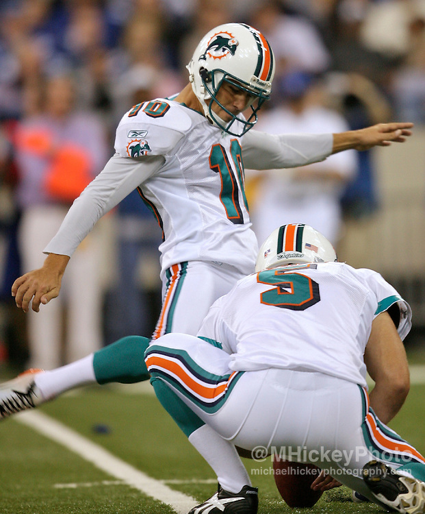 WireImage #12050506--Miami Dolphins place kicker Olindo Mare attempts a field goal during action against the Indianapolis Colts at the RCA Dome in Indianapolis, Indiana on December 31, 2006.