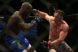 Saxon Delafield (Red) punches Sibusiso Mdoko (Blue) during the seventh bout of the Extreme Fighting Championships, EFC 52 held at the Grand West Casino in Cape Town, South Africa on the 5th August 2016<br /> <br /> Photo by:   Shaun Roy / Real Time Images