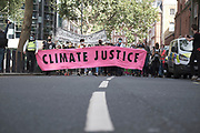 """Protesters walk down Marsham St at the """"Climate Justice is Migrant Justice"""" protest, outside Home Office, Marsham Street in central London on Friday, Sept 4, 2020. (VXP Photo/ Gio Strondl)"""