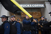 London, UK. Wednesday 19th November 2014. Student Assembly Against Austerity demonstration in protest at education spending cuts, tuition fees, and the resulting students debt. Police clash with protesters outside Starbucks.