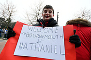 """A young fan shows off his signed hand made """"Welcome to Bournemouth Nathaniel"""" sign which was signed by Nathaniel Clyne before the The FA Cup 3rd round match between Bournemouth and Brighton and Hove Albion at the Vitality Stadium, Bournemouth, England on 5 January 2019."""