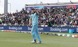 England's Chris Woakes celebrates taking the catch to dismiss Pakistan's Imam-ul-Haq during the ICC Cricket World Cup group stage match at Trent Bridge, Nottingham.