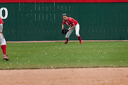 15 April 2012:  Left Fielder Lauren Kellar tracks down the ball and prepares to throw it back to the infield during an NCAA women's softball game between the Drake Bulldogs and the Illinois State Redbirds on Marian Kneer Field in Normal IL