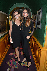Left to right, sisters LUCY PERFECT and ELLE CARING at a dinner to celebrate the 125th anniversary of the Dog's Trust held at Annabel's, Berkeley Square, London on 1st November 2016.