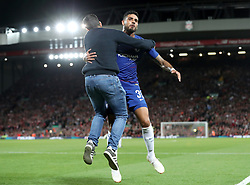 Chelsea's Emerson Palmieri (centre) celebrates scoring his side's first goal of the game with a fan during the Carabao Cup, Third Round match at Anfield, Liverpool.