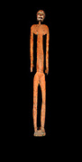 Ancestor figure from Latmul region of Papua New Guinea, 20th Century. This was a person of high rank indicated by the scars on his thighs