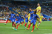 Romania Forward Florin Andone jumps in the air during the Group A Euro 2016 match between France and Romania at the Stade de France, Saint-Denis, Paris, France on 10 June 2016. Photo by Phil Duncan.