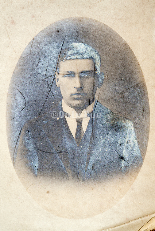 deteriorating oval head and shoulder portrait of a young adult man Early 1900s