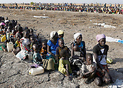 Women and children wait to be registered prior to a food distribution carried out by the United Nations World Food Programme (WFP) in Thonyor, Leer County, South Sudan, February 26, 2017.