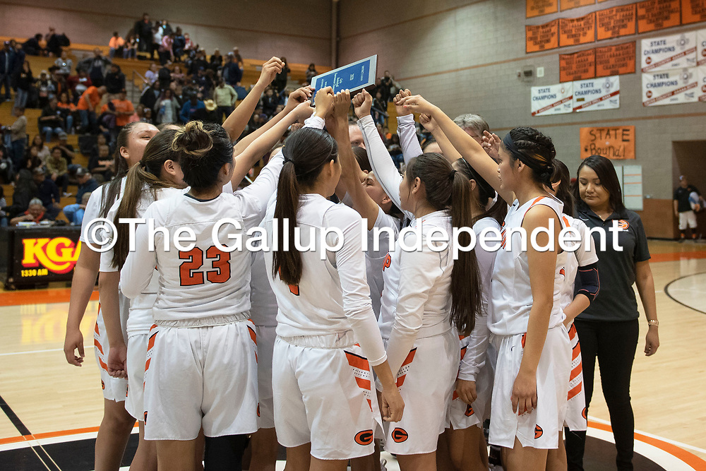 The Gallup Bengals celebrate their district 1-4A championship win Saturday night at Gallup High School in Gallup. The Bengals beat the Chieftains 72-57.