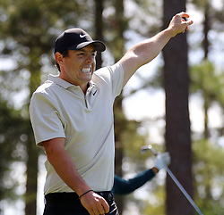 April 6, 2018 - Augusta, GA, USA - Rory Mcllroy reacts to Adam Scotts tee shot on four during the second round of the Masters at Augusta National Golf Club on Friday, April 6, 2018, in Augusta, Ga. (Credit Image: © Curtis Compton/TNS via ZUMA Wire)