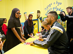NEWPORT, WALES - Tuesday, October 7, 2014: Wales' Neil Taylor signs autographs for pupils at the Mount Stuart School during a visit for a Show Racism the Red Card promotion ahead of the UEFA Euro 2016 qualifying match against Bosnia and Herzegovina. (Pic by David Rawcliffe/Propaganda)