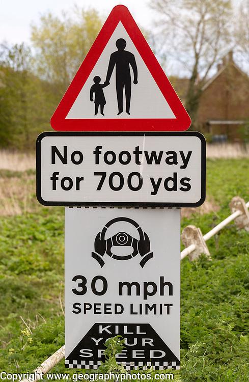Road traffic signs warning of hazards no footway 30 mph speed limit, Shottisham, Suffolk, England, UK