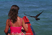 visitor and brown noddy share bow of outrigger boat for cruise through lagoon, Christmas Island ( Kiritimati ), Republic of Kiribati, northern Line Islands, equatorial Central Pacific Ocean, MR 299