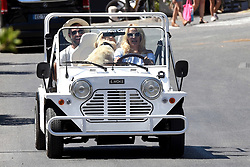 Saint Tropez,July the 26th 2017<br /> Pamela Anderson with a friend and her golden retriever pet dog strolling in a typical Saint Tropez Mini Moke car.<br /> ABACAPRESS.COM
