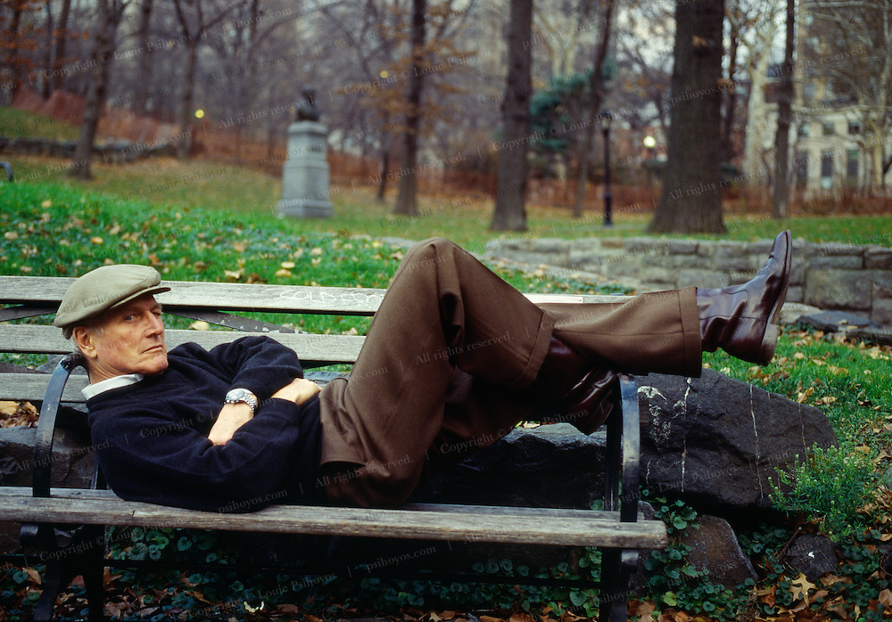 Paul Newman, Academy Award-winning actor and founder of Newman's Own a charitable organization on a Central Park Bench.