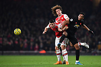 Football - 2019 / 2020 Premier League - Arsenal vs. Manchester United<br /> <br /> Arsenal's Granit Xhaka and David Luiz  battles for possession with Manchester United's Anthony Martial, The Emirates Stadium.<br /> <br /> COLORSPORT/ASHLEY WESTERN