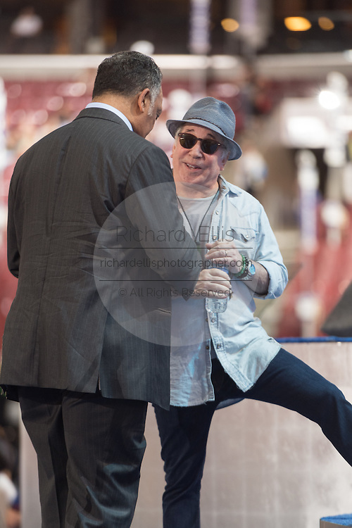 Legendary singer Paul Simon chats with civil rights leader Rev. Jesse Jackson during a break in rehearsal in preparation for the start of the Democratic National Convention at the Wells Fargo Center July 24, 2016 in Philadelphia, Pennsylvania.