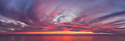 A colorful sunset sky over a calm sea in Oceanside, CA