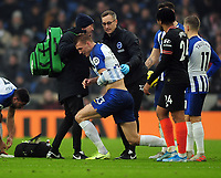 Football - 2019 / 2020 Premier League - Brighton & Hove Albion vs. Chelsea<br /> <br /> Dan Burn of Brighton leaves the field with an injured arm, at The Amex.<br /> <br /> COLORSPORT/ANDREW COWIE