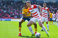 Tommy Rowe of Doncaster Rovers (10) and Joe Aribo of Charlton Athletic (17) in action during the EFL Sky Bet League 1 play off first leg match between Doncaster Rovers and Charlton Athletic at the Keepmoat Stadium, Doncaster, England on 12 May 2019.