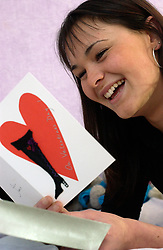17 year old girl reading a Valentine's Card on 14 February 2004; UK