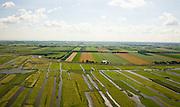 Nederland, Noord-Holland, Schermer, 14-07-2008; Eilandspolder in de voorgrond, voormalig veeneiland tussen de toenmalige meren Schermer en Beemster; de polder Beemster, op het tweede plan,  kent een strakke verkaveling (geometrische raster), dit in tegenstelling tot het grillige landschap van de Eilandspolder, die onstaan door drainage en vervening (winnen van turf); de Eilandspolder is in gebruik als weide- en hooiland en is beschermd natuurgebied voor water- en weidevogels, nat grasland en moeras; watervogels, veen.irregular pattern of drainage ditches  in typical Dutch peatland polder in the foreground  contrasts with the geometrical well-ordered polder Beemster in the backgroud; reclaimed landscape, Unesco world heritage. .luchtfoto (toeslag); aerial photo (additional fee required); .foto Siebe Swart / photo Siebe Swart