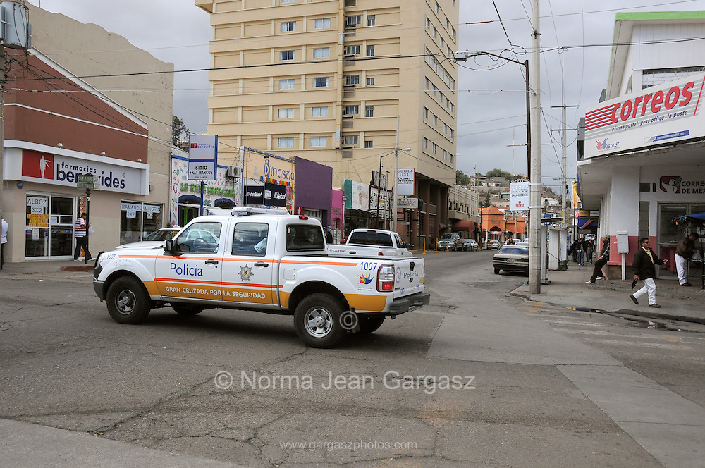 The border town of Nogales, Sonora, Mexico, has seen a decline in tourists from neighboring Arizona, USA, because of state department travel advisories due to drug cartel violence in the border towns. Law enforcement patrols the border town.