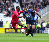 Photo: Greig Cowie<br />Middlesbrough v Arsenal. Barclaycard Premiership 19/04/2003<br />Thierry Henry bursts forward as George Boateng hauls him back