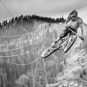 Kyle Dowman gets table top air on Teton Pass near Wilson, Wyoming.