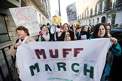 © Licensed to London News Pictures. 10/12/2011. London, UK.  Women march down Harley Street, famous for being the centre of cosmetic surgery clinics, in London today (10/12/2011) to take part in Muff March a protest against the the pornification of female private parts. Muff March believes women are being pressurised by porn culture to get a 'designer vagina'. Photo credit: Ben Cawthra/LNP