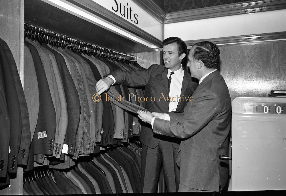 17/07/1967<br /> 07/17/1967<br /> 17 July 1967<br /> Opening of new men's salon at Brown Thomas, Grafton Street, Dublin. Brendan O'Reilly, the TV personality opened a new Mens Department in Brown Thomas and Co. Ltd.. In the new department was a hairdressing salon where while getting your hair done it was possible to make phone calls from the chair. Image shows Mr. John McGuire, (right), Managing Director, Brown Thomas Group showing some of the ready made suits to Brendan O'Reilly.