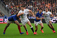 Rugby Union - 2020 Guinness Six Nations Championship - France vs. England<br /> <br /> England's Owen Farrell evades the tackle of Frances's Boris Palu, at The Stade de France, Paris.<br /> <br /> COLORSPORT/ASHLEY WESTERN