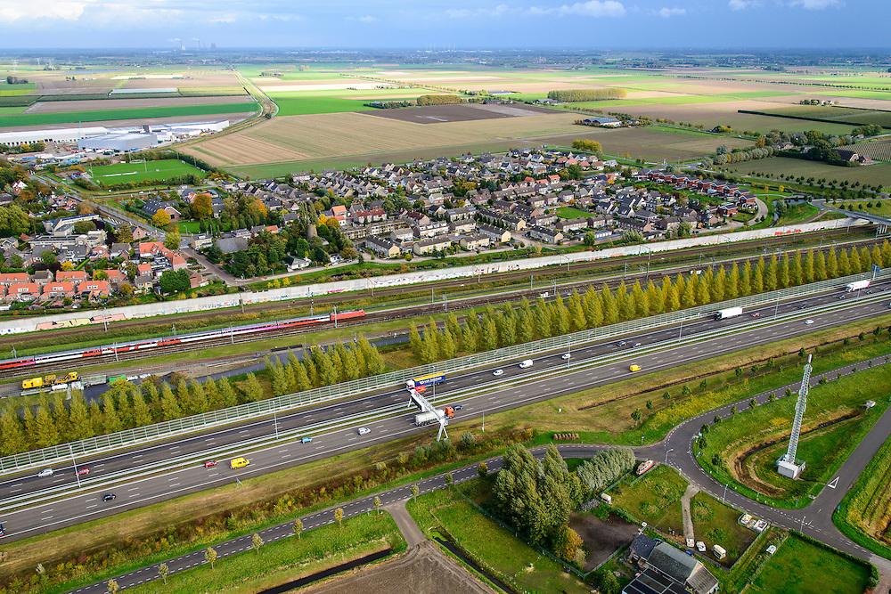 Nederland, Provincie, Plaats, 23-10-2013;<br /> <br /> QQQ<br /> luchtfoto (toeNederland, Noord-Brabant, Gemeente Moerdijk, 23-10-2013; Infrabundel, combinatie van autosnelweg A16 gebundeld met de spoorlijn van de HSL ter hoogte van Zevenbergschen Hoek. Intercity direct (voorheen Fyra) onderweg naar Breda.<br /> Combination of motorway A16 and the HST railroad, Brabant (southern Netherlands)<br /> luchtfoto (toeslag op standard tarieven);<br /> aerial photo (additional fee required);<br /> copyright foto/photo Siebe Swart
