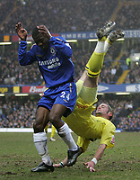 Photo: Lee Earle.<br /> Chelsea v Colchester United. The FA Cup. 19/02/2006. Chelsea's Shaun Wright Phillips (L) feels the force of John White.