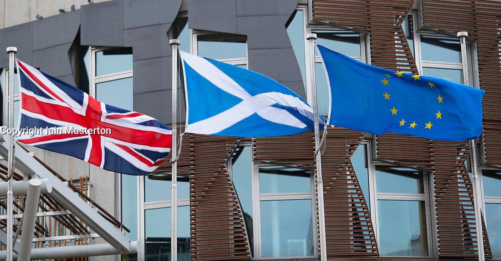 Edinburgh, Scotland, UK. 31 January, 2020. Flags flying outside the Scottish Parliament at Holyrood in Edinburgh. The Parliament voted to continue flying the European flag after the UK leaves the European Union tonight. Iain Masterton/Alamy Live News.