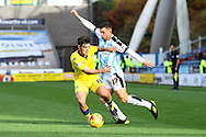 Alex Mowatt of Leeds united gets in front of Harry Bunn of Huddersfield Town. Skybet football league Championship match, Huddersfield Town v Leeds United at the John Smith's Stadium in Huddersfield, Yorks on Saturday 7th November 2015.<br /> pic by Chris Stading, Andrew Orchard sports photography.