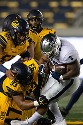 Nevada running back Devonte Lee (2) is stacked up by a quartet of California defenders during the fourth quarter of an NCAA college football game, Saturday, Sept. 4, 2021, in Berkeley, Calif. (AP Photo/D. Ross Cameron)