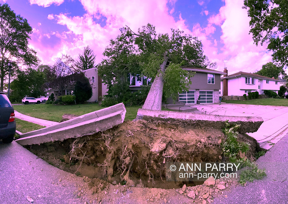 North Merrick, New York, U.S. August 4, 2020. Tropical Storm Isaias slams into Long Island, causing widespread tree damage and power outages.