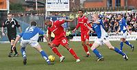 Junior Agogo (centre) attacks for Nottingham Forest.  Chesterfield defenders (left) Aaron Downes & (right) Derek Niven