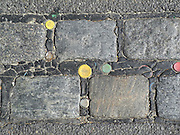 Berlin, GERMANY. General Views,  GV's.  bottle tops trodden into the tar/asphalt  used as grouting between the stone cobbles.  Brandenburg Gate on May Day 2011.  Saturday  01/05/2011 [Mandatory Credit; Peter Spurrier/Intersport-images]. Street Photos
