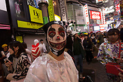 A clown costume during the Halloween celebrations Shibuya, Tokyo, Japan. Saturday October 27th 2018. The celebrations marking this event have grown in popularity in Japan recently. Enjoyed mostly by young adults who like to dress up, drink , dance and misbehave in parts of Tokyo like Shibuya and Roppongi. There has been a push back from Japanese society and the police to try to limit the bad behaviour.
