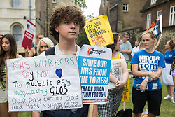 NHS workers from the grassroots NHSPay15 campaign prepare to march from opposite the Houses of Parliament to 10 Downing Street to present a petition signed by over 800,000 people calling for a 15% pay rise for NHS workers on 20th July 2021 in London, United Kingdom. At the time of presentation of the petition, the government was believed to be preparing to offer NHS workers a 3% pay rise in 'recognition of the unique impact of the pandemic on the NHS'.
