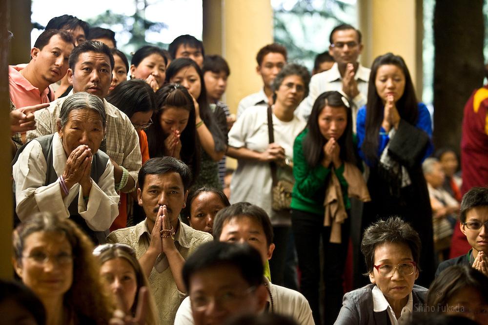 INDIA - Dalai Lama <br /> Buddhists react as they take a look at Dalai Lama during a morning prayer ceremony in Dharamsala, India, May 26, 2009.