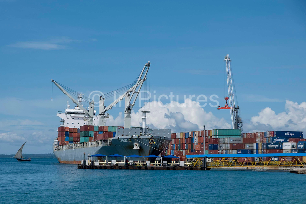 The Portuguese owned Ubena container ship unloading containers at Stone Town Dock, Zanzibar, Tanzania.