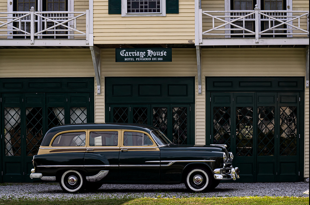 An old Pontiac Station Wagon parked out front of  The Cariage House at Hotel Pemaquid, Est. 1888, in Pemaqid, Maine.